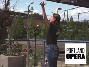 Portland Opera singing on balcony