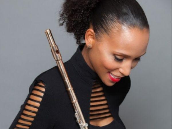 Allison Loggins-Hull holding her flute