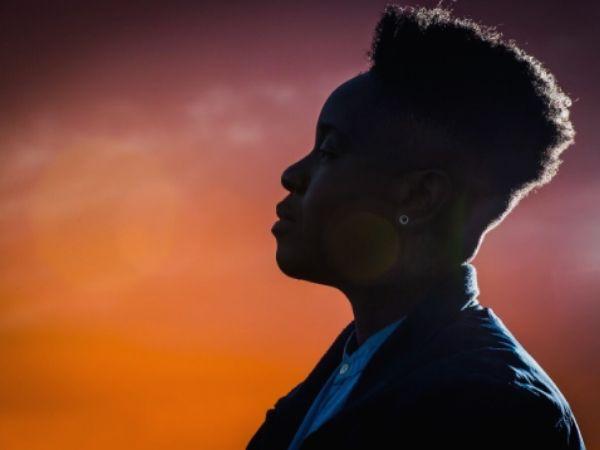 Chari Glogovac-Smith profile photo with a sunset