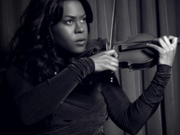 Tona Brown playing the violin from the GLAAD website