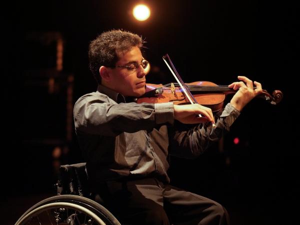 photo of man playing violin