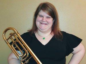 Woman holding brass instrument