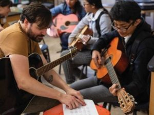 young musicians playing guitar