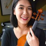 Avery Hsieh holding a violin