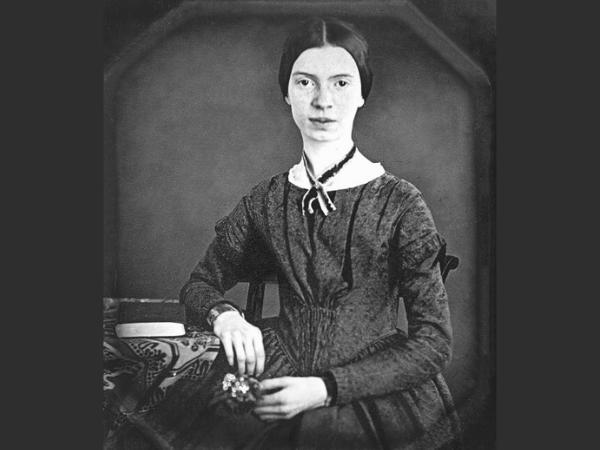 woman in grey dress sitting for a portrait
