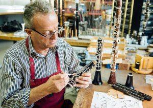 Man building clarinets at Herbert Neureiter in Austria