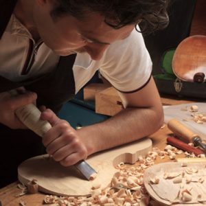 Man building violin