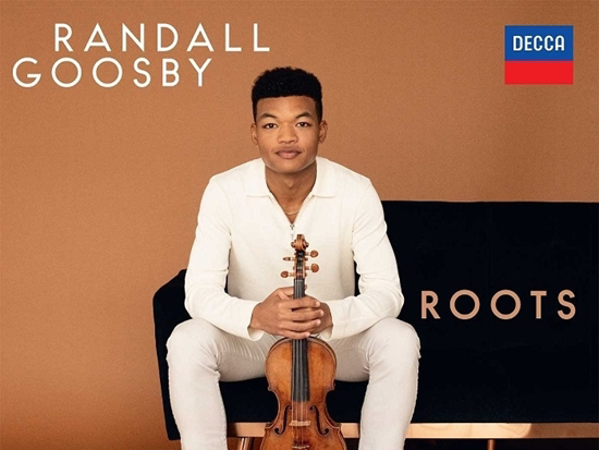 Randall Goosby Roots cd cover. A man sits on a couch holding his violin.